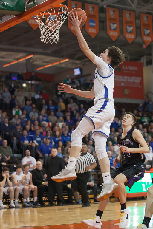 . Jen Forbus - The Morning Journal<br> Bay\'s Cade Gergye cashes in on a breakaway with a layup.