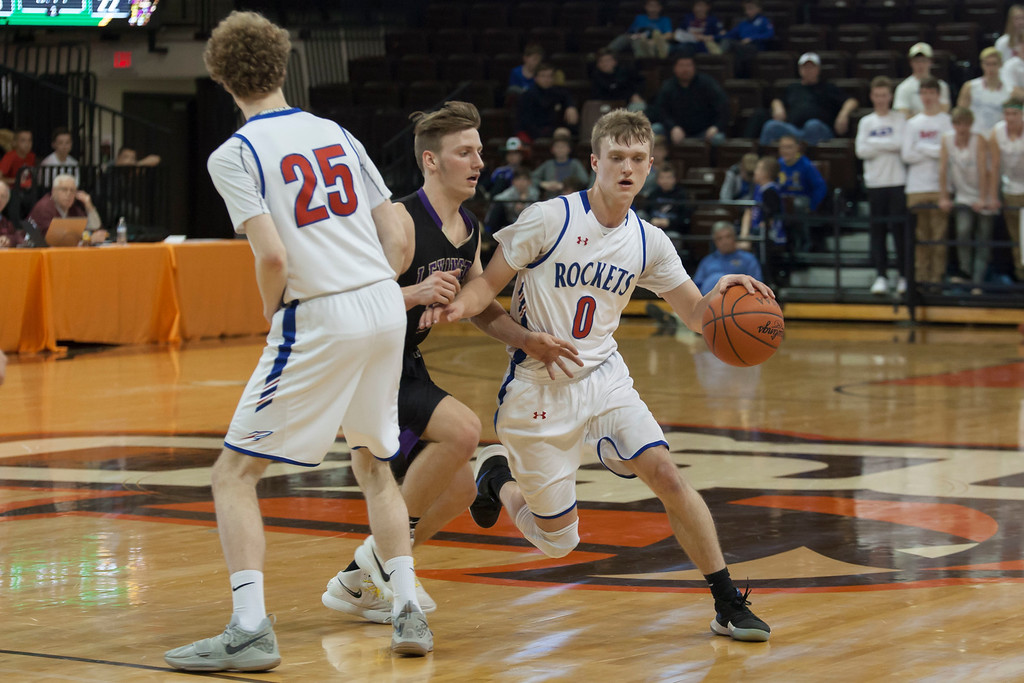 . Jen Forbus - The Morning Journal<br> Bay\'s Jack Maxwell (25) sets a pick for teammate Erik Painter as he tries to shake defense from Lexington\'s Mason Kearns.