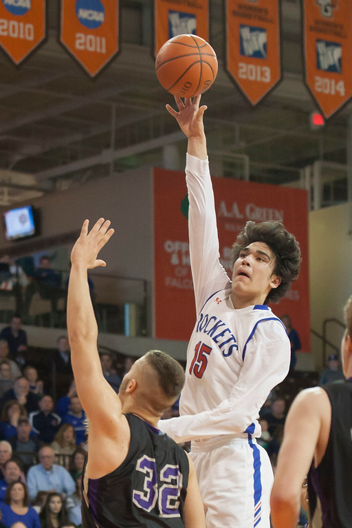 . Jen Forbus - The Morning Journal<br> RJ Sunahara\'s altitude is unmatched by Lexington\'s Cade Stover as he tosses a shot to the basket.