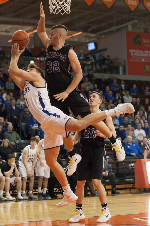 . Jen Forbus - The Morning Journal<br> Bay\'s Francis Sherman makes a gallant effort at a shot despite Lexington\'s Cade Stover\'s leaping block.