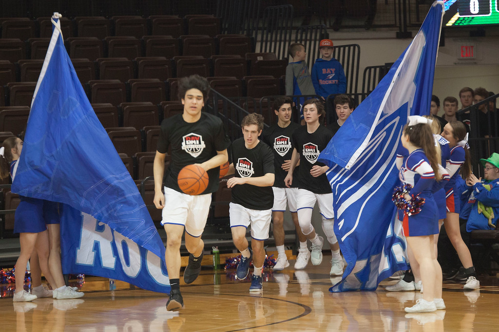 . Jen Forbus - The Morning Journal<br> Bay senior RJ Sunahara leads his squad onto the court for their regional final contest against Lexington Saturday afternoon.