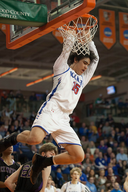 . Jen Forbus - The Morning Journal<br> RJ Sunahara of Bay has a little hang time with his ally oop dunk against Lexington in the regional final contest Saturday afternoon.