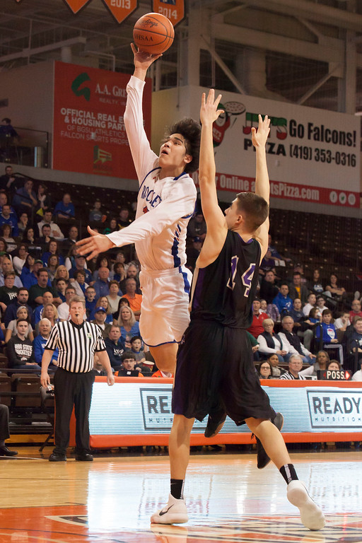 . Jen Forbus - The Morning Journal<br> Bay\'s RJ Sunahara lobs a shot up to the basket as Lexington\'s Jack Dials tries to impede him.