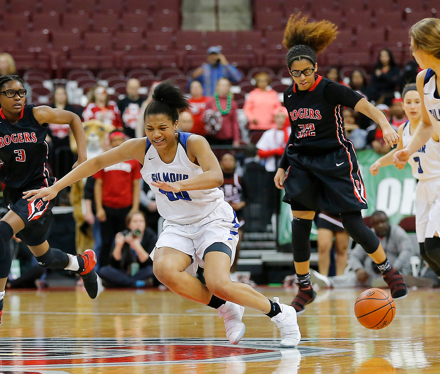 . Joe Maiorana- ImpactActionPhotos.com Gilmour Academy\'s Naz Hillmon (00) looses the ball to Lauran Smith (22) during action in the OHSAA division II state final at Value City Arena, Columbus. The Lancers fell to Toledo Rogers 51-37 on Saturday.