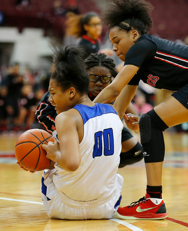 . Joe Maiorana- ImpactActionPhotos.com Gilmour Academy\'s Naz Hillmon (00) looses the ball to Zia Cooke during action in the OHSAA division II state final at Value City Arena, Columbus. The Lancers fell to Toledo Rogers 51-37 on Saturday.
