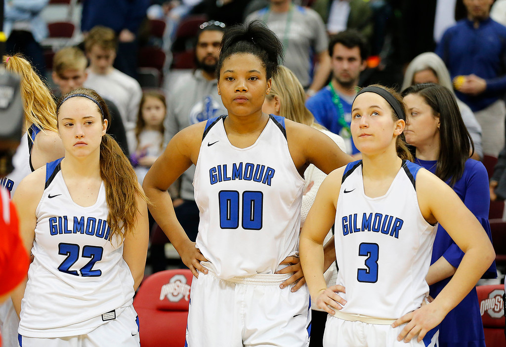 . Joe Maiorana- ImpactActionPhotos.com Gilmour Academy teammates (from left) Emma Gurley (22), Naz Hillmon (00) and Sarah Bohn (right) show their disappointment following action in the OHSAA division II state final at Value City Arena, Columbus. The Lancers fell to Toledo Rogers 51-37 on Saturday.