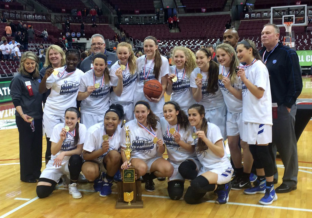 . John Kampf - The News-Herald The Gilmour girls basketball team celebrates its Division III state championship on March 18 in Columbus.