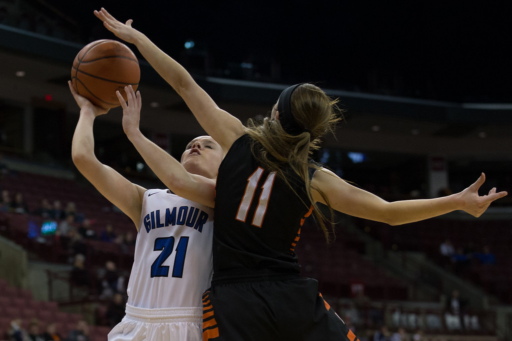 . Michael Johnson - The News-Herald Gilmour Academy\'s Annika Corcoran (21) goes up for a lay up against Versailles\' Camille Watren (11) during the 2017 OHSAA Girls State Final game at the Schottenstein Center in Columbus on March 18.  The Gilmour girls Basketball team defeated the Versailles Tigers 56-54 to become State Champions.