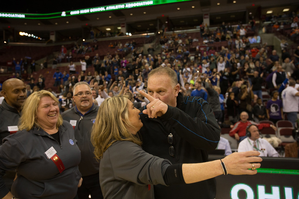 . Michael Johnson - The News-Herald The Gilmour Aademy Coaching Staff celebrates after winning the 2017 OHSAA Girls State Final game at the Schottenstein Center in Columbus on March 18.  The Gilmour girls Basketball team defeated the Versailles Tigers 56-54 to become State Champions.