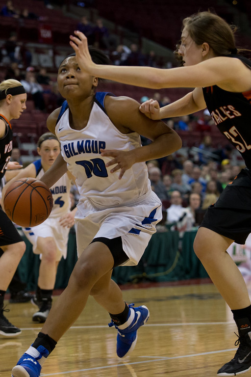 . Michael Johnson - The News-Herald Gilmour Academy\'s Naz Hillmon (00) drives past Versailles\' Danielle Winner (32) during the 2017 OHSAA Girls State Final game at the Schottenstein Center in Columbus on March 18.  The Gilmour girls Basketball team defeated the Versailles Tigers 56-54 to become State Champions.