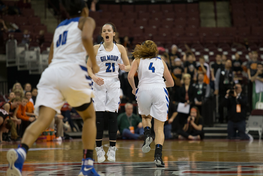 . Michael Johnson - The News-Herald Gilmour Academy\'s Annika Corcoran celebrates after scoring in the final minutes of the  2017 OHSAA Girls State Final game at the Schottenstein Center in Columbus on March 18.  The Gilmour girls Basketball team defeated the Versailles Tigers 56-54 to become State Champions.