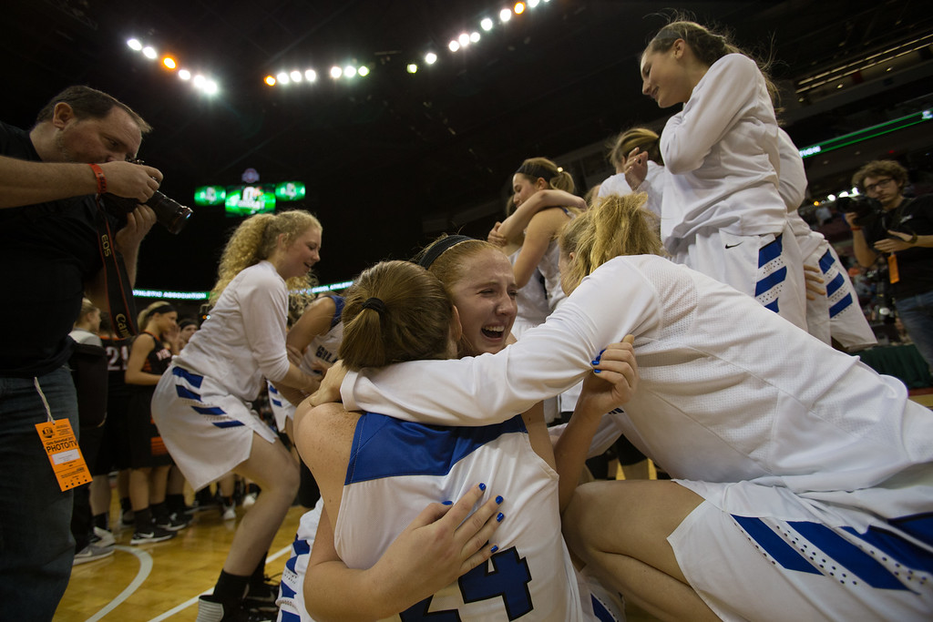 . Michael Johnson - The News-Herald Gilmour Academy celebrates after winning the 2017 OHSAA Girls State Final game at the Schottenstein Center in Columbus on March 18.  The Gilmour girls Basketball team defeated the Versailles Tigers 56-54 to become State Champions.