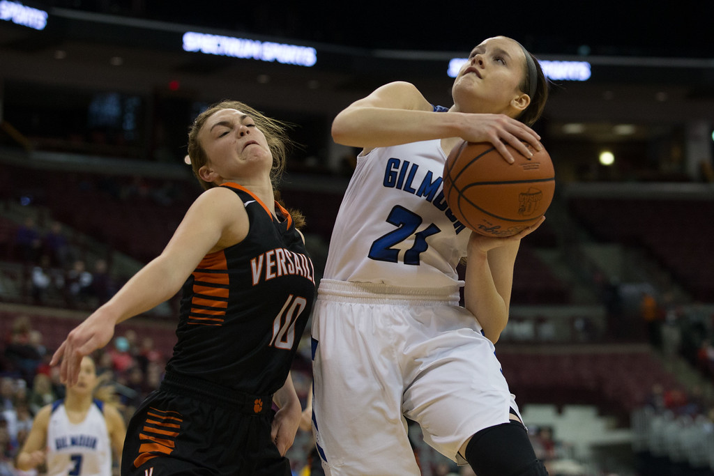 . Michael Johnson - The News-Herald Gilmour Academy\'s Annika Corcoran (21) goes up for a lay up against Versailles\' Kami McEldowney (10) during the 2017 OHSAA Girls State Final game at the Schottenstein Center in Columbus on March 18.  The Gilmour girls Basketball team defeated the Versailles Tigers 56-54 to become State Champions.