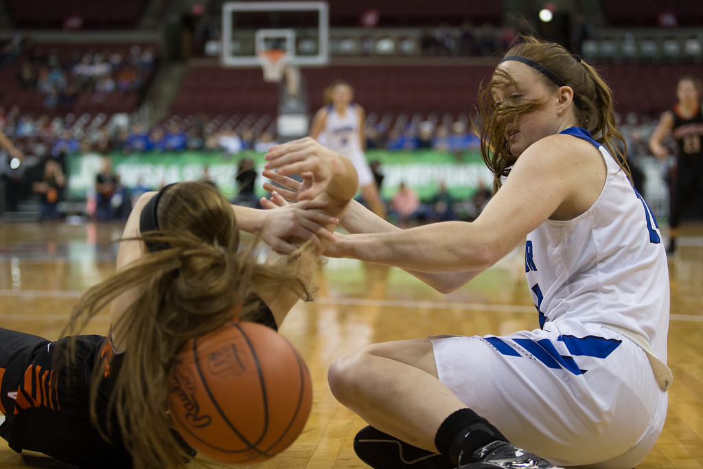 . Michael Johnson - The News-Herald Gilmour Academy\'s Sydney Diedrich (right) dives for the ball against a Versailles defender during the 2017 OHSAA Girls State Final game at the Schottenstein Center in Columbus on March 18.  The Gilmour girls Basketball team defeated the Versailles Tigers 56-54 to become State Champions.