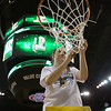Michael Johnson - The News-Herald<br /> Gilmour Academy's Sydney Diedrich cuts a piece of the net after winning the 2017 OHSAA Girls State Final game at the Schottenstein Center in Columbus on March 18.  The Gilmour girls Basketball team defeated the Versailles Tigers 56-54 to become State Champions.