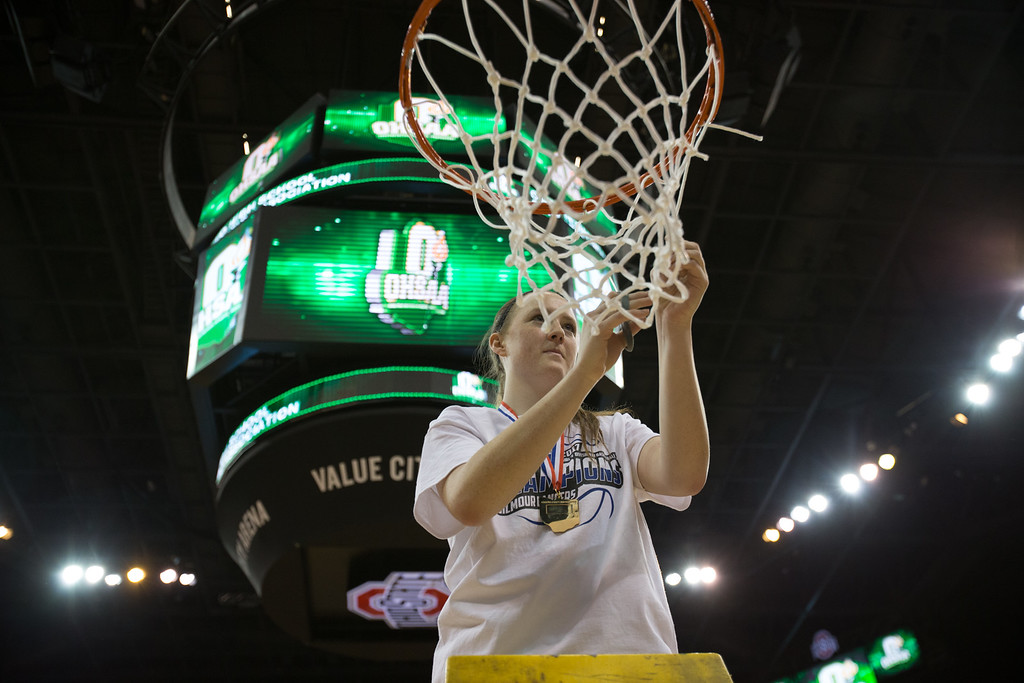 . Michael Johnson - The News-Herald Gilmour Academy\'s Sydney Diedrich cuts a piece of the net after winning the 2017 OHSAA Girls State Final game at the Schottenstein Center in Columbus on March 18.  The Gilmour girls Basketball team defeated the Versailles Tigers 56-54 to become State Champions.