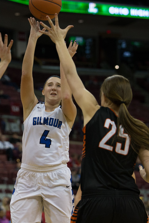 . Michael Johnson - The News-Herald Gilmour Academy\'s Emily Kelley (4) takes a shot over Versailles defenders during the 2017 OHSAA Girls State Final game at the Schottenstein Center in Columbus on March 18.  The Gilmour girls Basketball team defeated the Versailles Tigers 56-54 to become State Champions.