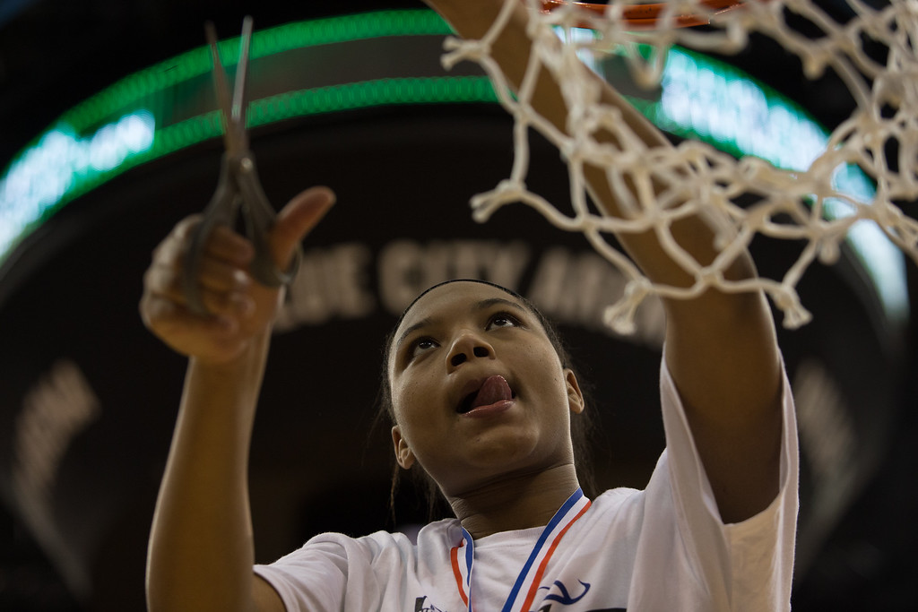 . Michael Johnson - The News-Herald Gilmour Academy\'s Naz Hillmon cuts a piece of the net after winning the 2017 OHSAA Girls State Final game at the Schottenstein Center in Columbus on March 18.  The Gilmour girls Basketball team defeated the Versailles Tigers 56-54 to become State Champions.