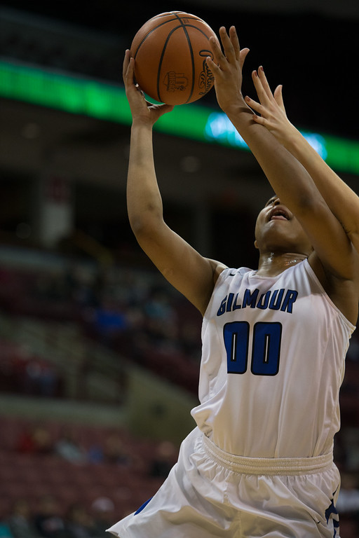. Michael Johnson - The News-Herald Gilmour Academy\'s Naz Hillmon (00) goes up against a Versailles defender during the 2017 OHSAA Girls State Final game at the Schottenstein Center in Columbus on March 18.  The Gilmour girls Basketball team defeated the Versailles Tigers 56-54 to become State Champions.