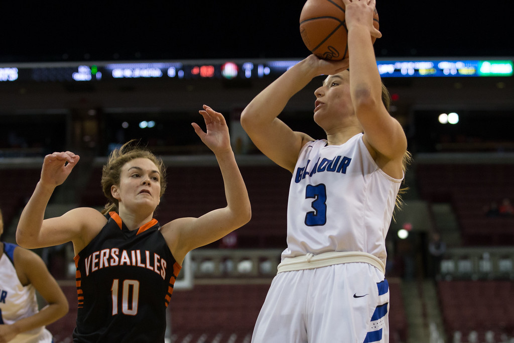 . Michael Johnson - The News-Herald Gilmour Academy\'s Sarah Bohn (3) takes a shot over Kami McEldowney (10) of Versailles during the 2017 OHSAA Girls State Final game at the Schottenstein Center in Columbus on March 18.  Gilmour defeated the Versailles Tigers 56-54 to become State Champions.