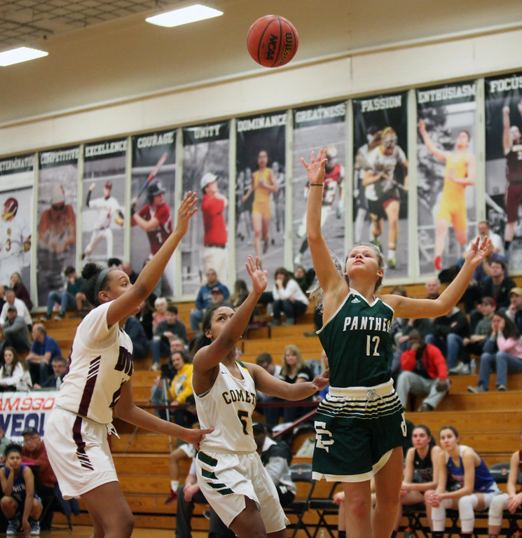 . Randy Meyers - The Morning Journal Elyria Catholic\'s Faith Williams  puts up a running shot over Faith Lewis of Amherst and Jalen Gibbs of  Wellington during the Girl\'s Rising Stars game on Sunday