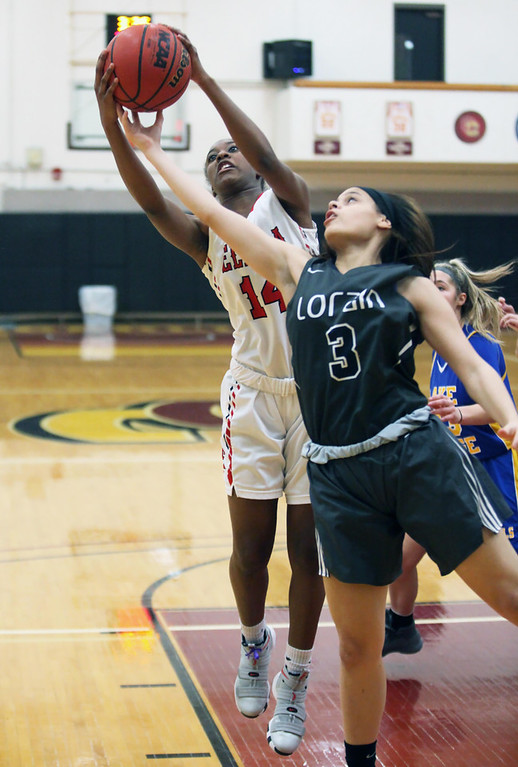 . Randy Meyers - The Morning Journal Elyria\'s Toni McClinton battles Nae  Bohannon of Lorain for a rebound during the Girl\'s Rising Stars All Star  game
