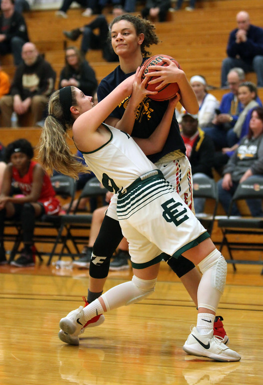 . Randy Meyers - The Morning Journal Kenadee Bryant of Elyria Catholic  ties up Savannah Bauer of Elyria (right) during the first game of the  Lorain County Girl\'s All Stars on Sunday