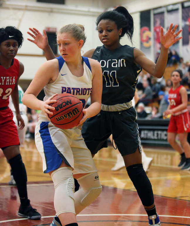 . Randy Meyers - The Morning Journal Lorain\'s Phyllicia Weatherspoon  defends Lauryn Brown of Open Door during the first game of the Lorain  County Girl\'s All Stars on Sunday