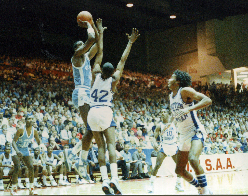 . Courtesy Tim Robertson Jr. St. Joseph\'s Treg Lee shoots against Dayton Dunbar in a 1987 Class AAA state semifinal.