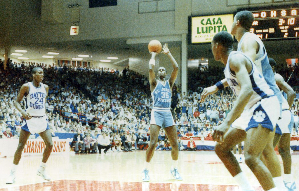 . Courtesy Tim Robertson Jr. St. Joseph\'s Treg Lee shoots a free throw against Dayton Dunbar in a 1987 Class AAA state semifinal.