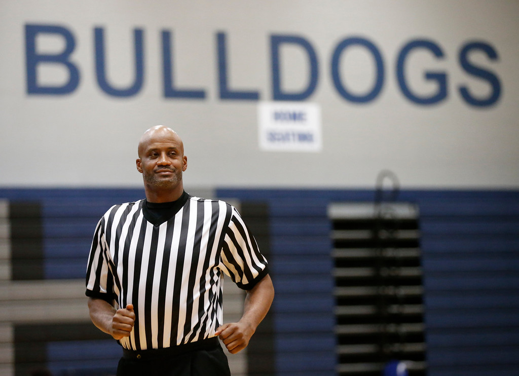 . Former Ohio State basketball player Treg Lee referee\'s Friday\'s basketball game between South and Africentric at South HIgh School on January 14, 2016. (Barbara J. Perenic/The Columbus Dispatch)