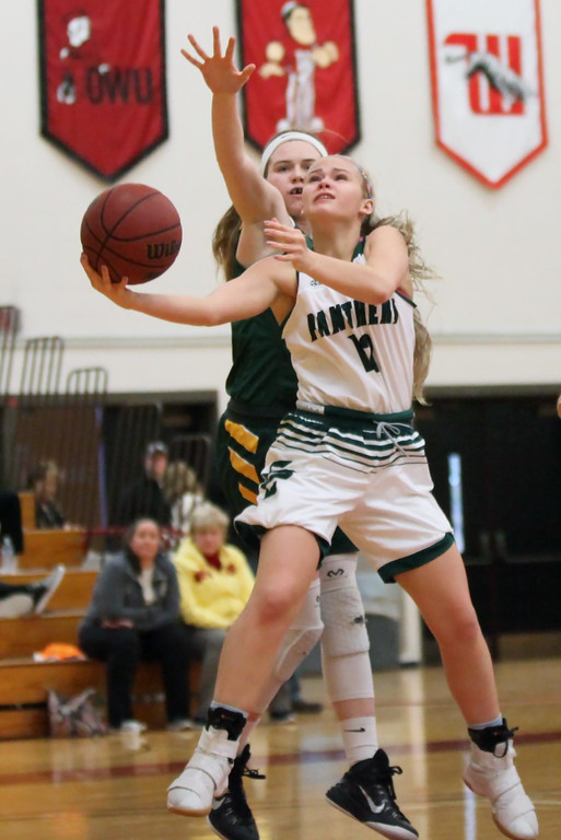 . Randy Meyers - The Morning Journal Elyria Catholic\'s Faith Williams   puts up a underhand shot  past Kate Iliff of Amherst during the Rising   Stars game at the 2017 Lorain County All Stars event