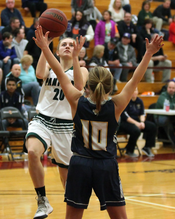 . Randy Meyers - The Morning Journal Elyria Catholic\'s Sam Filiaggi   shoots over Danielle Blagojevic of North Ridgeville during the Lorain   County Girls All Star game on Sunday