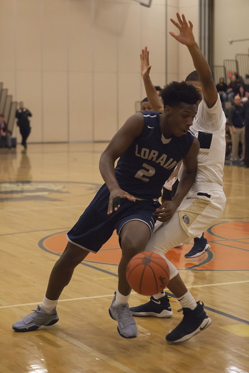 . Jen Forbus - The Morning Journal<br> Lorain forward Taevon Pierre-Louis drives by his defender toward the basket on Feb. 3.