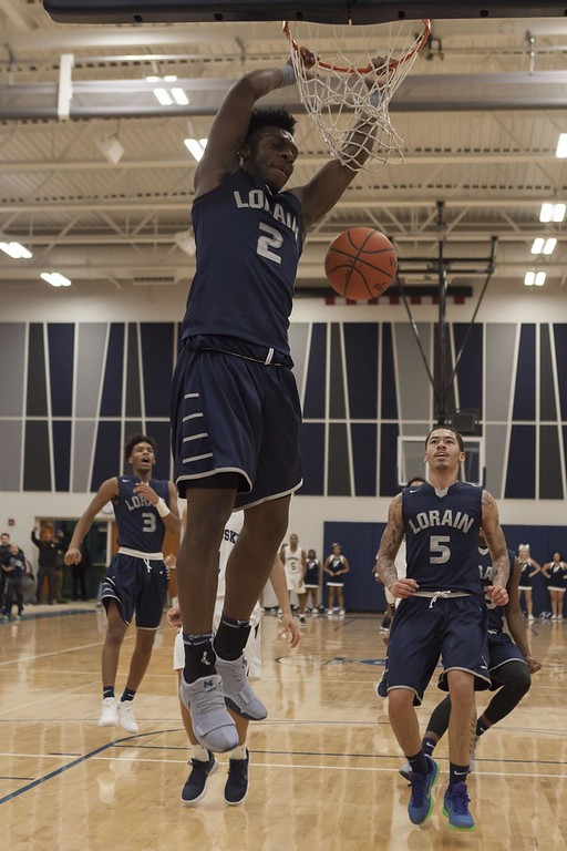 . Jen Forbus - The Morning Journal<br> Lorain\'s Taevon Pierre-Louis throws down a dunk against Sandusky on Dec. 30.