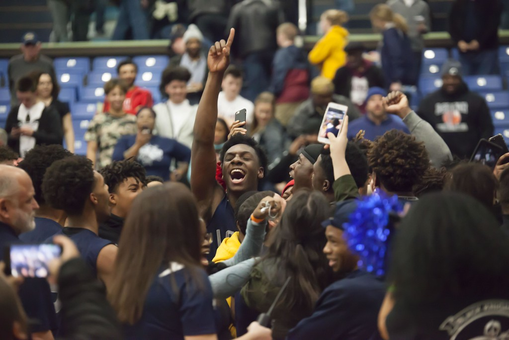 . Jen Forbus - The Morning Journal<br> Lorain celebrates an amazing win in overtime against St. Edward in a regional semifinal.