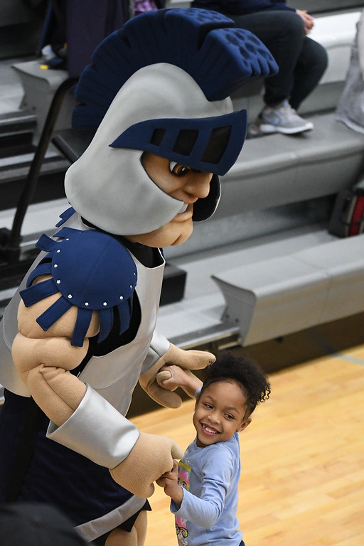 . Eric Bonzar�The Morning Journal<br> A young fan dances with Lorain mascot Titus, Jan. 26, 2018. The Lorain Titans hosted the Warrensville Heights Tigers in a Lake Erie League Conference match-up, Friday night. The Titans beat the Tigers 80-49.