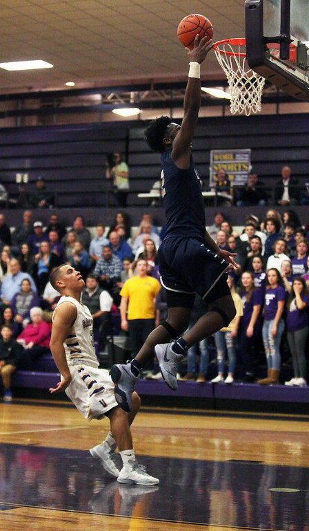 . Randy Meyers - The Morning Journal<br> Lorain\'s Taevon Pierre-Louis drives to the rim on a fast break during the second quarter against Vermilion on Dec. 5.