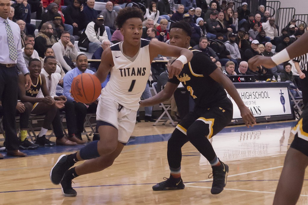 . Jen Forbus - The Morning Journal<br> Lorain\'s Jordan Jackson looks for a path to the basket as Cleveland Heights\' Javon Roberts follows close on defense on Jan. 18.