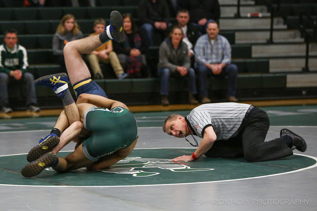 . Sharon Holy - The News-Herald Lake Catholic\'s Kevon Freeman wrestles an opponent from St. Ignatius on Feb. 9.