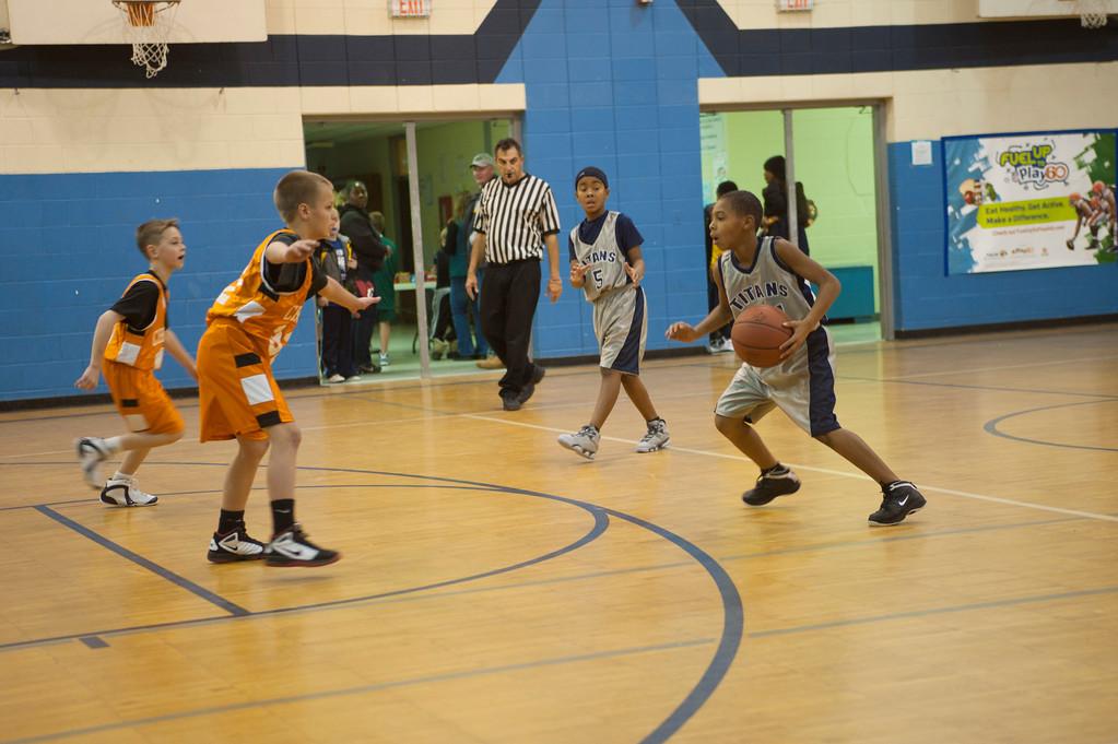 . Courtesy Lorain Athletics Lorain Junior Titan thrid-grader Devon Grant looks to get around an opponent as teammate, second-grader Jordan Jackson, calls for a pass.