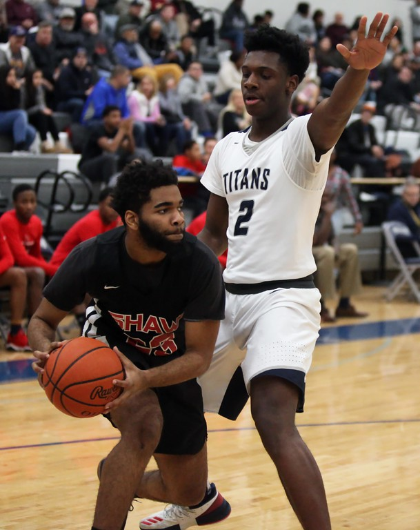. Randy Meyers - The Morning Journal<br> Taevon Pierre-Louis of Lorain applies full court pressure against Leo Armstrong of Shaw during the second quarter on Feb. 2.