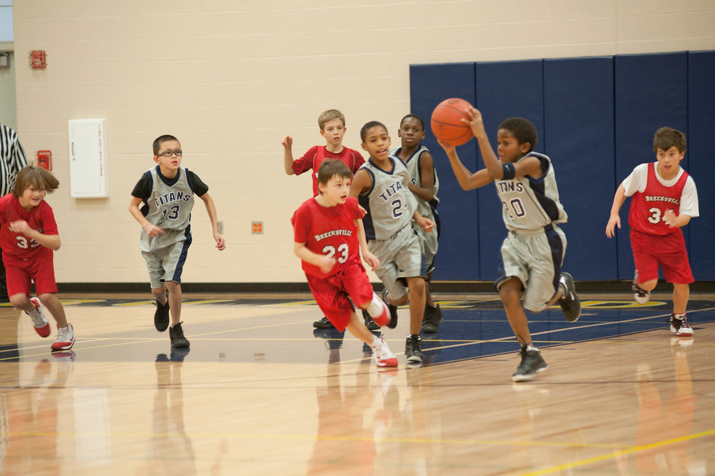 . Coutesy Lorain Athleitcs Lorain Junior Titan third-grader Kameron Davis brings the ball up court as teammates, including third-grader Taevon Pierre-Louis, follow.