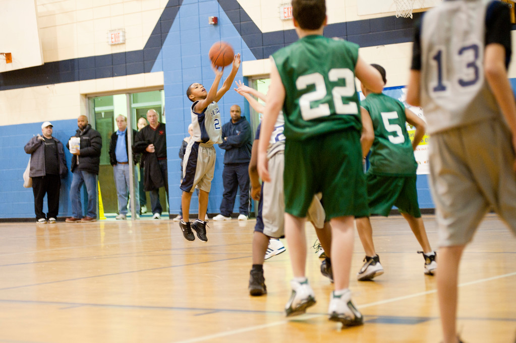 . Coutesy Lorain Athletics Lorain Junior Titan third-grader Devon Grant takes a jump shot.