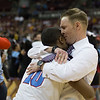 VASJ head coach, Babe Kwasniak, hugs Terrance Lawler after the Vikings' 54-52 victory over Roger Bacon in the Division III State Final on March 25 at the Schottenstein Center in Columbus.