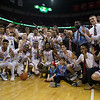 VASJ players and coaches pose for a photo after the Vikings' 54-52 victory over Roger Bacon in the Division III State Final on March 25 at the Schottenstein Center in Columbus.