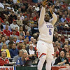 VASJ's William Butler shoots a three-pointer during the Vikings' 54-52 victory over Roger Bacon in the Division III State Final on March 25 at the Schottenstein Center in Columbus.