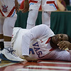 VASJ's William Butler  lies on the floor after being fouled by a Spartan defender during the Vikings' 54-52 victory over Roger Bacon in the Division III State Final on March 25 at the Schottenstein Center in Columbus.