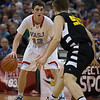 VASJ's Daniel McGarry (12) looks to drive on Roger Bacon's Nick Pfriem (55) during the Vikings' 54-52 victory over Roger Bacon in the Division III State Final on March 25 at the Schottenstein Center in Columbus.