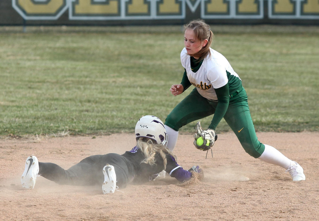 . Randy Meyers - The Morning Journal Amherst shortstop Kasey McGraw tags  out Madi Herrington of Keystone at second base on Monday